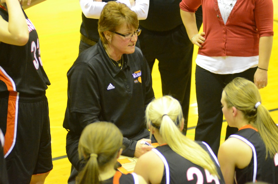 Warsaw girls basketball coach Michelle Harter talks to her team during a timeout at Northridge Saturday night. The No. 10 Tigers remained undefeated with a huge 52-39 NLC win.