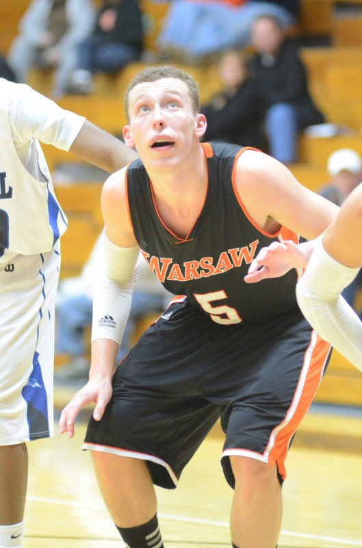 Warsaw's John Swanson prepares to go after a rebound on a free throw attempt Tuesday night. The senior had a game-high 14 points to lead the Tigers to a win versus Elkhart Central.