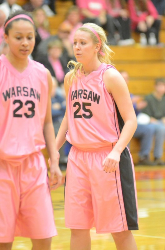Lindsay Baker (at right) and Jennifer Walker-Crawford talk during a break in a recent game. The pair of senior stars helped Warsaw remain undefeated Saturday night with a 57-44 NLC win over Goshen.