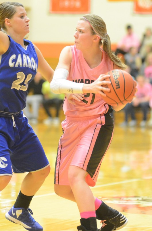 Senior guard Melanie Holladay looks for room against Carroll Wednesday night. Holladay played a strong all-around game as Warsaw won 62-43 to remain undefeated.