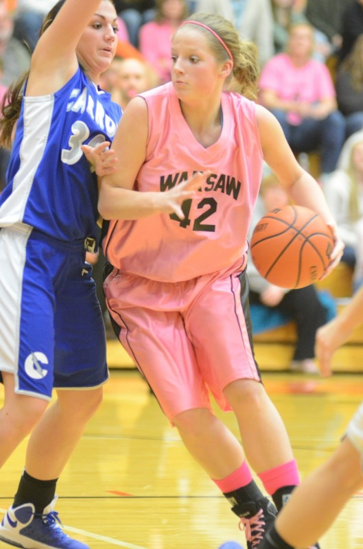 Warsaw's Nikki Grose goes to the basket Wednesday night. The junior had 18 points and 11 rebounds as the No. 10 Tigers beat Fort Wayne Carroll 62-43.