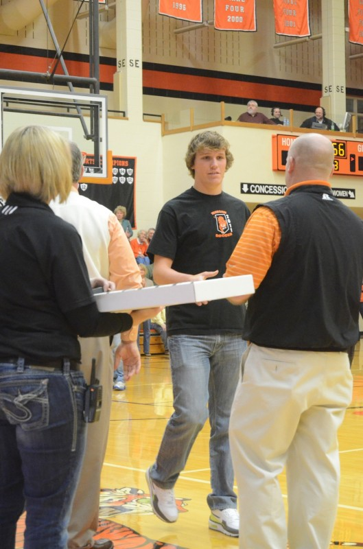 WCHS senior Michael Yantz receives his state runner-up ring Friday night. Yantz was the goalie for the Class 2-A state runner-up Tigers.