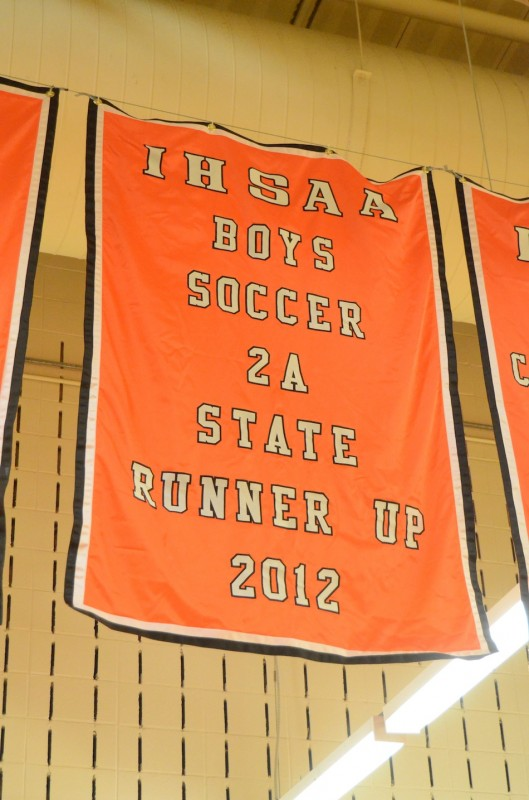 A banner honoring the 2012 Warsaw boys soccer team was unveiled Friday night in the Tiger Den.