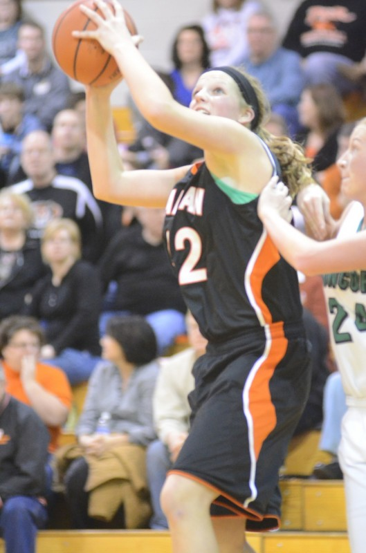 Warsaw's Nikki Grose powers inside for two of her game-high 20 points Saturday night. Grose led the undefeated Tigers to a 52-21 NLC win at Concord.