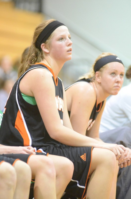 Nikki Grose and Lindsay Baker watch intently from the Warsaw bench late in the game Saturday night.