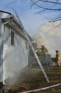 Fire crews battled a blaze at a home at 1681 E. 900 N. near Milford. (Photo by Deb Patterson)