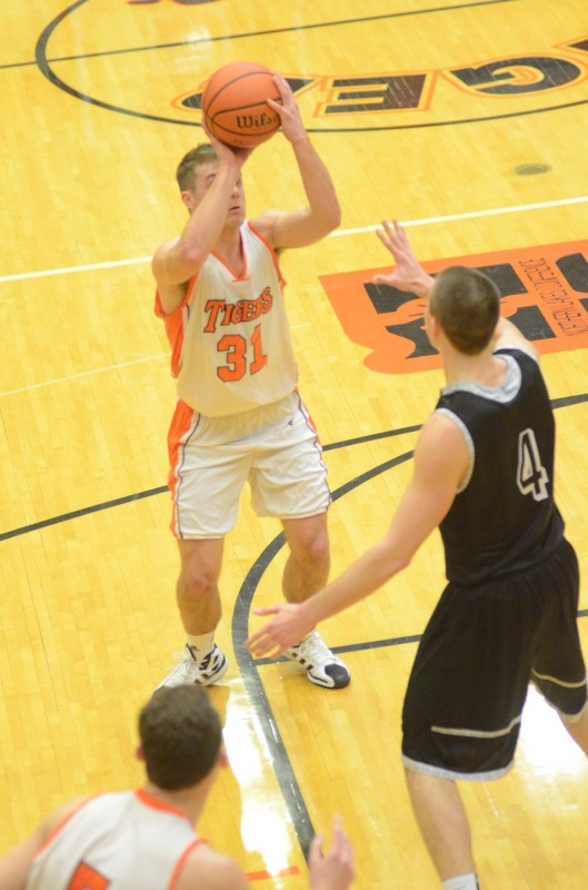 Warsaw senior Taylor Cone prepares to shoot over NorthWood's Zach Zurcher Friday night.
