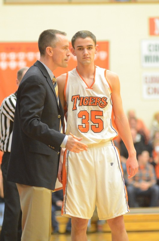 Warsaw assistant coach David Wayne talks with Jordan Stookey Friday night. Wayne's halftime speech inspired the Tigers to a 67-51 win over NorthWood.