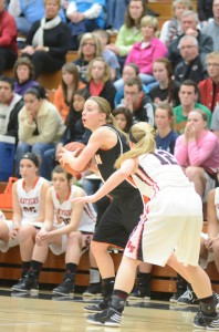 Melanie Holladay of Warsaw looks for help as Maddie Schwartz defends her Saturday night.