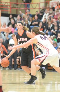 Warsaw's Nikki Grose makes a move past Morgan Olson Saturday night at NorthWood. The Tigers lost for the first time this season, 34-30 to the Panthers.