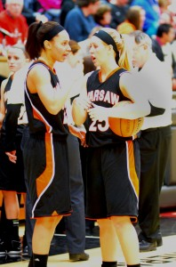 Jennifer Walker-Crawford, left, and Lindsay Baker of Warsaw chat during their game at NorthWood Saturday night. Warsaw drew Elkhart Memorial in the first round of the Concord Sectional.