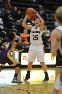 Warsaw's Lindsay Baker looks to pass Thursday night versus Marion. The Tiger standout tied a career high with 26 points in a 76-49 win.