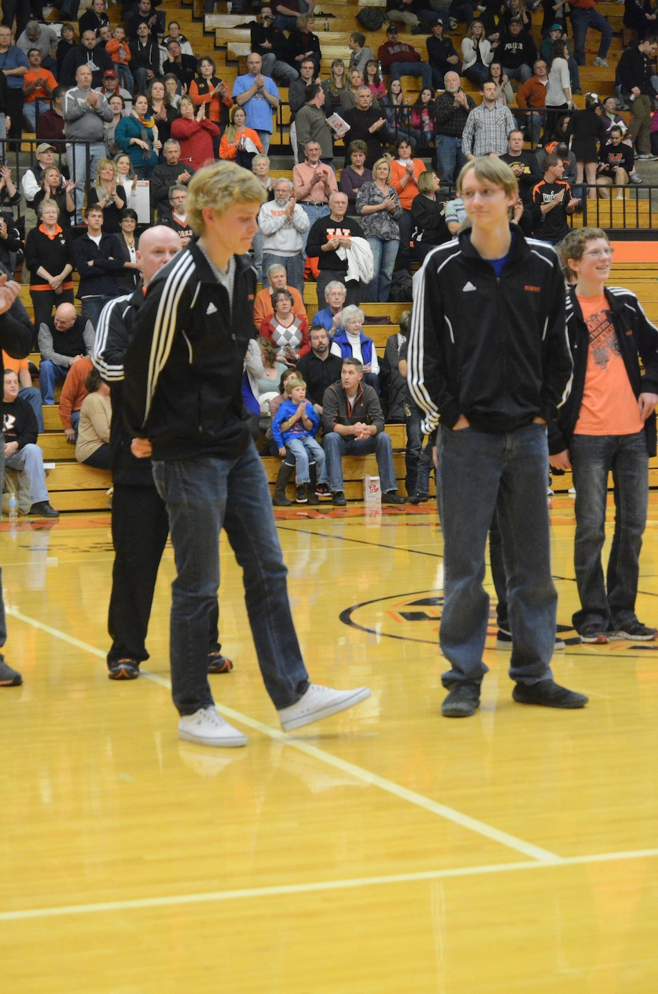 Warsaw seniors Jake Poyner (left) and Robert Murphy are honored Friday night at the boys basketball game. The pair of All-State performers led Warsaw to a fourth-place finish at the State Finals this past fall.