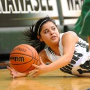 Cassie Martinez of Wawasee dives for a loose ball against Tippecanoe Valley.