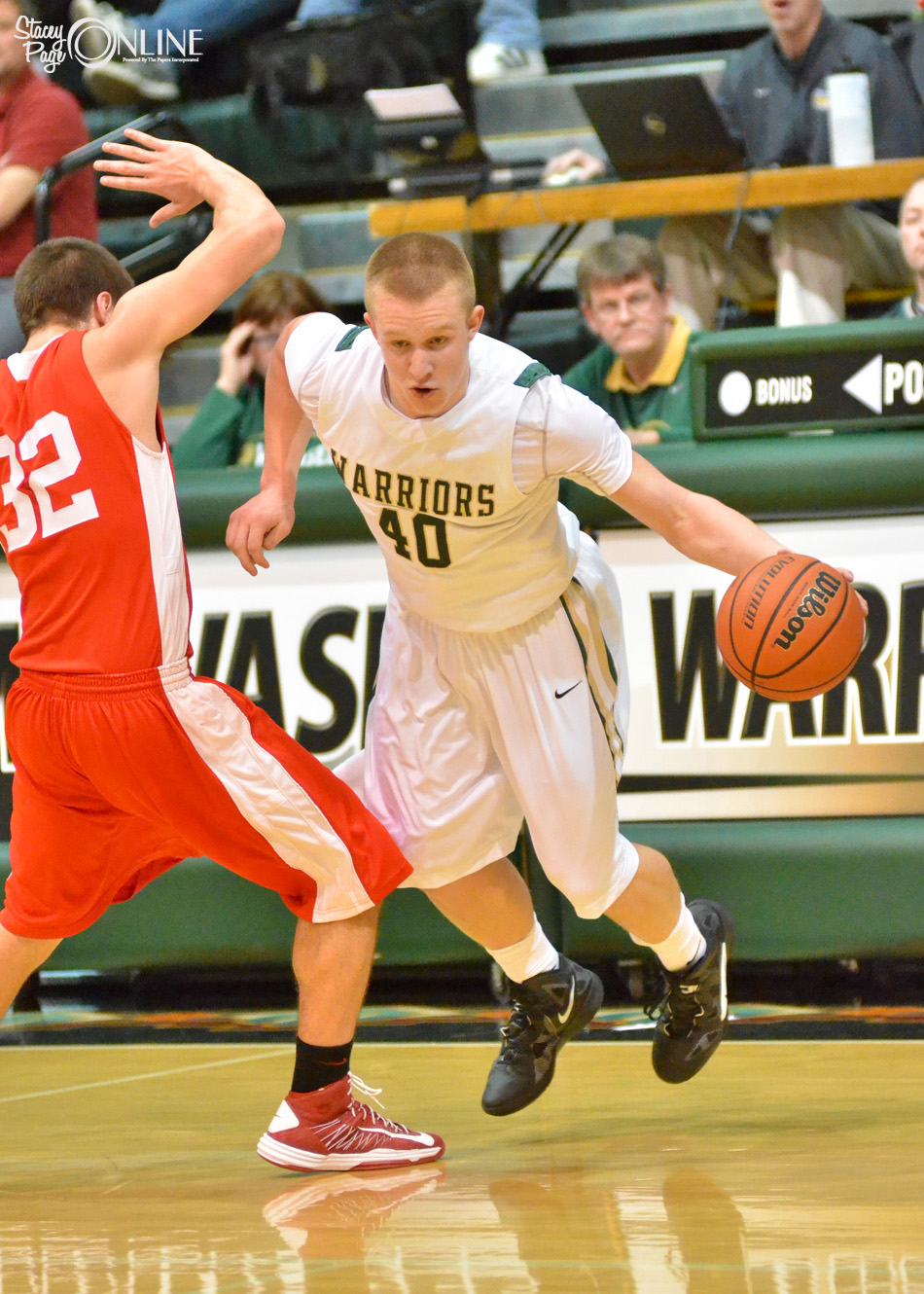 Wawasee's Alex Clark dribbles around Plymouth's Kyser McCrammer Friday night. The game was overshadowed by the news Wawasee student KC Ochs had committed suicide earlier in the day, sombering the atmosphere surrounding the contest.