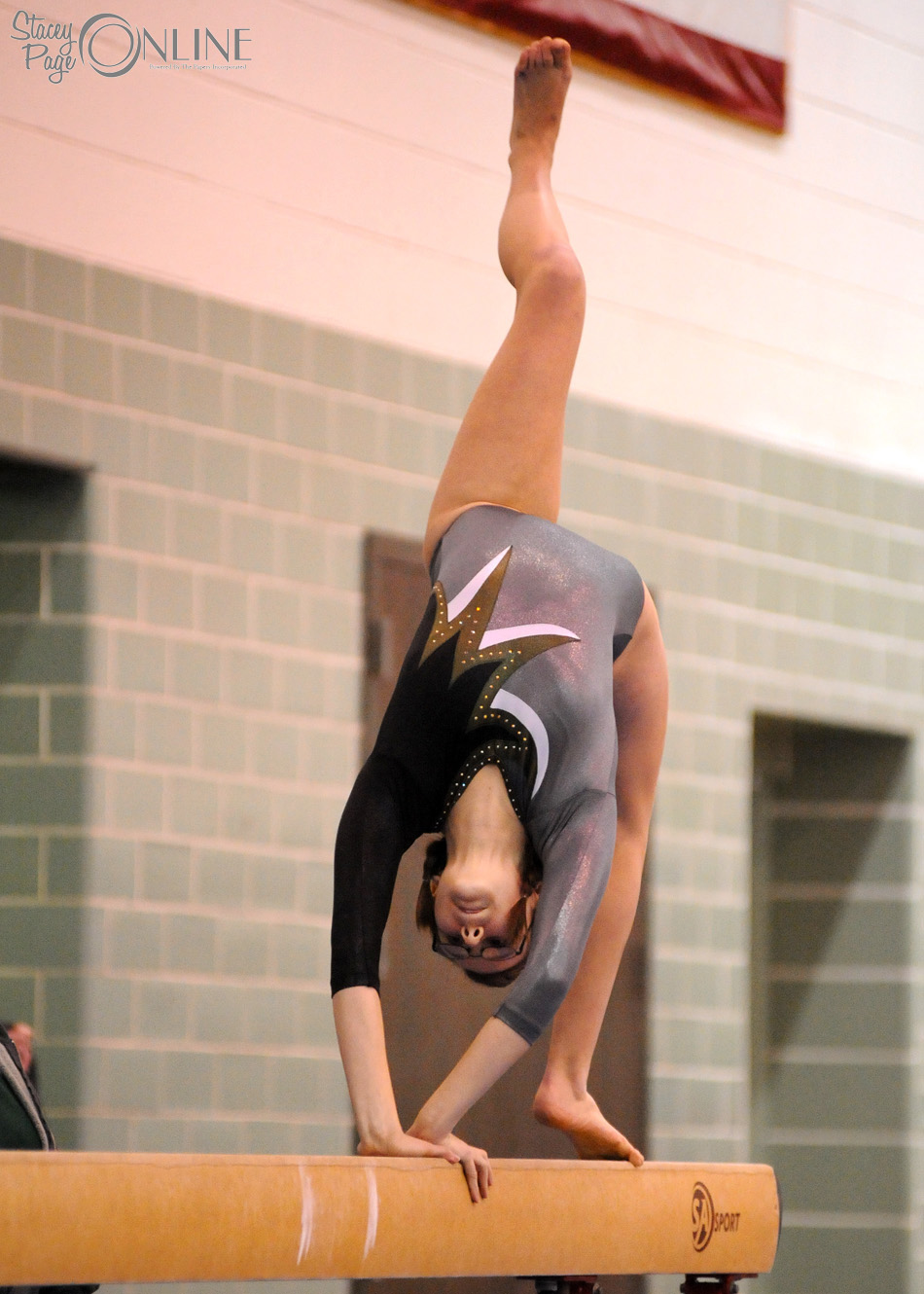 Wawasee's Ashleigh Frecker was one of several sent to varsity duty against West Noble, including this routine on beam. (Photos by Mike Deak)