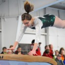 Wawasee's Ashleigh Frecker flies through her vault attempt at the Blazer Invite.