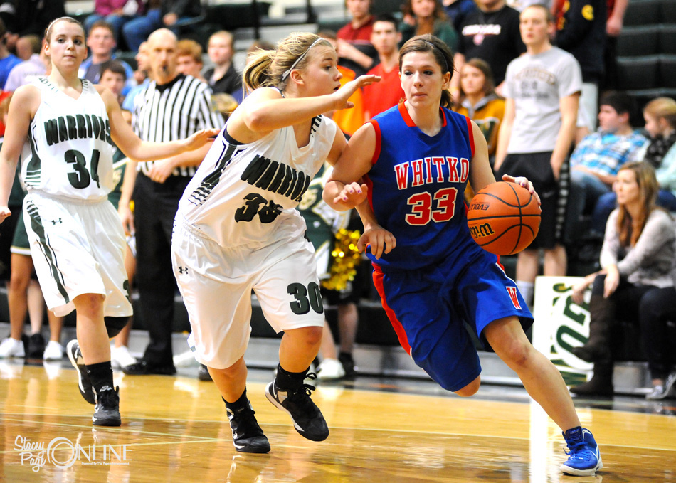 Whitko's Maddie Gawthrop looks to dribble past Wawasee's Kylee Rostochak Tuesday night during Wawasee's 45-26 win. (Photos by Mike Deak)