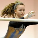 Warsaw's Jo Richard flies through her bars routine Tuesday night at Wawasee. (Photos by Mike Deak)