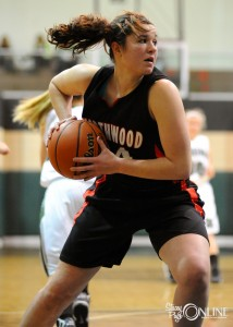 NorthWood forward Morgan Olson rips down one of her 11 rebounds.