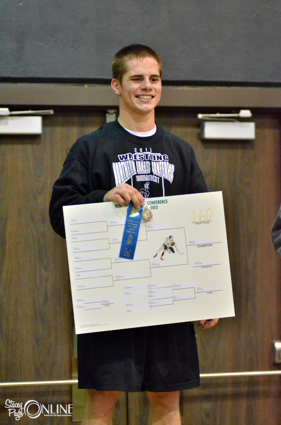 Wawasee 160-pounder Nick Rozow stands proud after winning the weight class at the Northern Lakes Conference Wrestling Championships. (Photos by Nick Goralczyk)