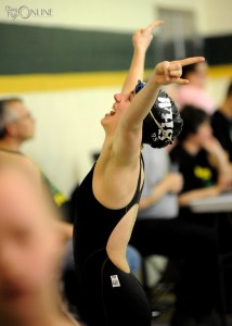 After a successful swim in the medley relay, Rachel Rozow of Wawasee plays to the fans during the Northridge Girls Swimming Sectional prelims.