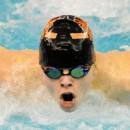 Zach Taylor of Warsaw speeds to the finals of the individual medley.