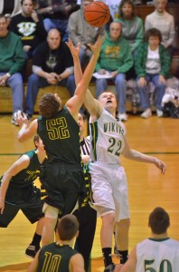 Valley's Tanner Andrews goes up for the opening tip-off against EJ Solina of Wawasee Friday night.