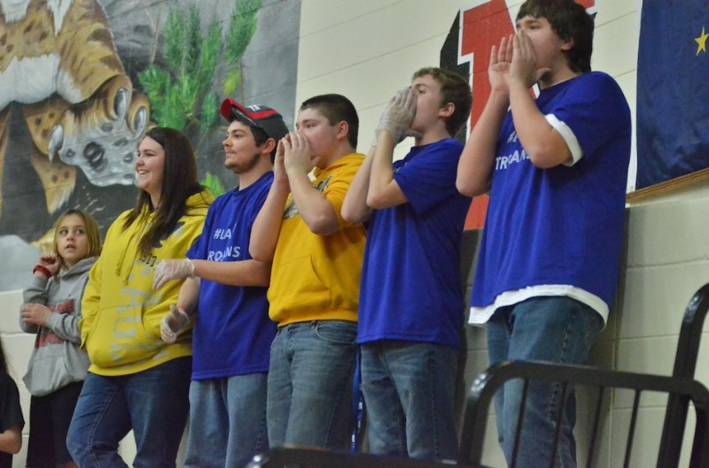 Triton fans cheer on their team Saturday night during the girls basketball sectional championship game at Oregon-Davis.