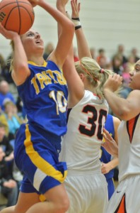 Taylor Hatfield powers her way to the basket over Tatum Schultz of Culver Friday night.