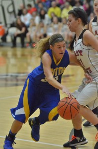 Triton senior Shana Anderson drives past Jesse Avarone of Oregon-Davis Saturday night in the sectional final at OD (Photos by Nick Goralczyk)