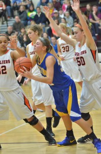 Shana Anderson, who led Triton with a game-high 18 points, finds herself surrounded by a host of Culver defenders.