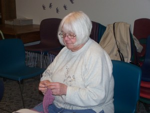 Charlotte Siegfriend, Milford, knits and chats with fellow knitters at the afternoon knitting club that meets every other Friday at 1:30 pm in the library meeting room. The next meeting will be on Feb. 22 at 1:30 pm.