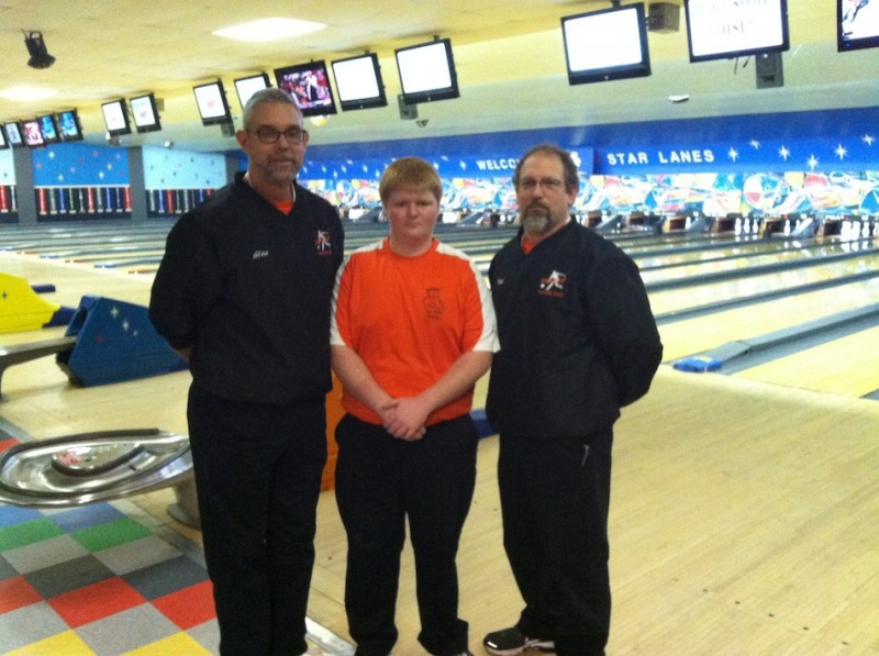 WCHS sophomore Chris Stichter will also compete as an individual in the bowling semi state Saturday. Pictured above is Stichter (center) with coaches Glen Ransbottom (at left) and Kirk Wyman (at right)  (Photo provided)