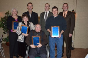 A number of individuals were recognized during the annual Kosciusko County Soil and Water Conservation District Annual Meeting Tuesday night. Shown are some of the award recipients. In front, from left, are Carole Koos and Paul Sibray, Environmental Education Award recipients; and Darrel Byer, River Friendly Farmer Award. Standing in back are Jackie Horn, Environmental Education Award; and Scott Brown, Stanley Brown and Neil Brown of the A.J. Brown and Sons Farm which received the Conservation Farmer of the Year Award. (Photo by Deb Patterson)