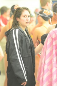 Warsaw's Cynthia Juarez looks up into the crowd after winning the sectional title Saturday in the 500 freestyle race at WCHS.