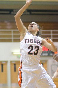 Jennifer Walker-Crawford scores two of her game-high 18 points for Warsaw Tuesday night.