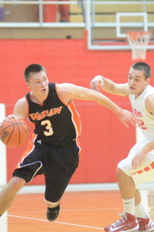 Jared Bloom heads to the hoop versus Plymouth Thursday night. The Warsaw senior had 11 points in a 57-56 loss in the NLC finale.