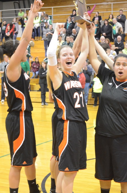 Warsaw seniors Melanie Holladay and Gabby Monroy celebrate a sectional championship Saturday night at Concord.