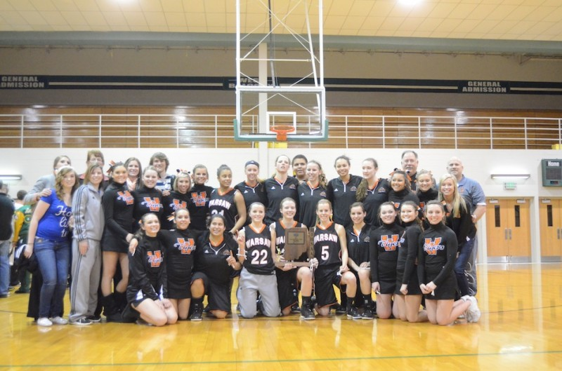 The Warsaw girls basketball team is all smiles Saturday night after winning the sectional championship at Concord. The Tigers advance to play Penn in the Valparaiso Regional next Saturday.