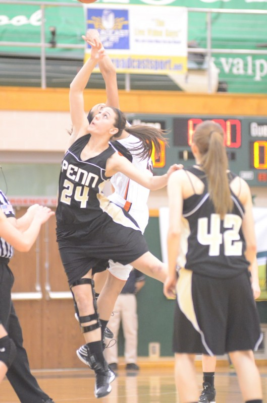 Penn's Caroline Buhr goes up against Jennifer Walker-Crawford for the opening tip-off Saturday at Valparaiso.
