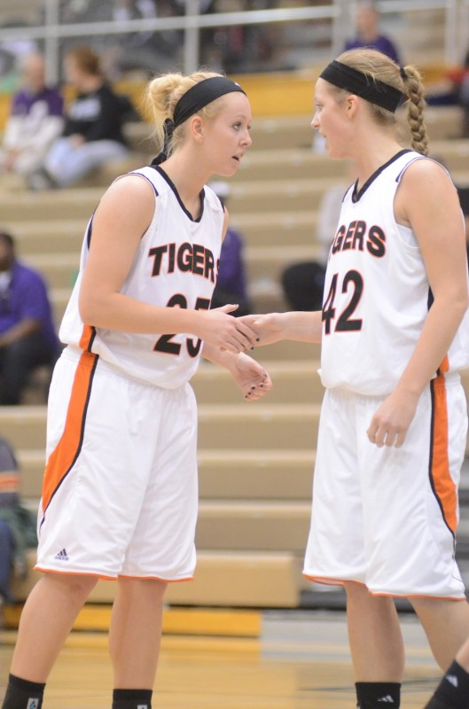 Warsaw's Lindsay Baker (left) and Nikki Grose encourage each other during regional play at Valparaiso Saturday afternoon. The pair helped the Tigers beat Penn 49-42 in a semifinal game.