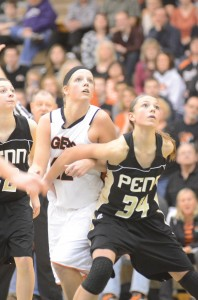 Warsaw standout Nikki Grose and Camryn Buhr of Penn look to rebound Saturday. Grose had a stellar showing with 22 points and 12 rebounds in Warsaw's win.