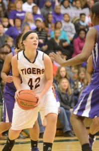 Nikki Grose heads for the hoop versus Merrillville. The junior had 13 points and 16 rebounds in a 42-41 win in the regional final.