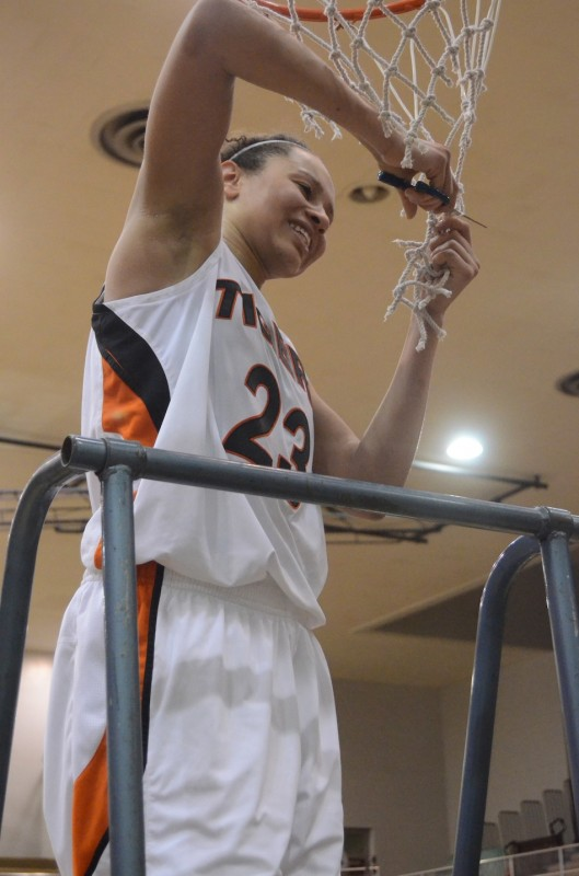 Jennifer Walker-Crawford gets her piece of the twine after leading Warsaw to a regional championship Saturday night at Valparaiso.