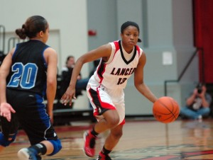 Grace College junior Juaneice Jackson set a program record for points in a season Saturday.