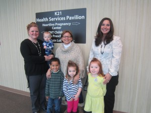 From left are Amy Rosswurm, TNT program coordinator; District 22 State Rep. Rebecca Kubacki; Angie Wood, HPC executive director; and children from TNT Childcare and Preschool Ministry. (Photo provided)