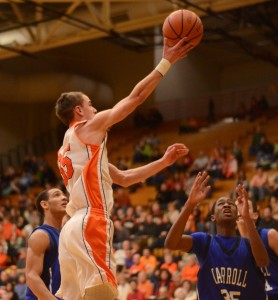 Jordan Stookey flies in for a hoop for the Tigers Friday night.