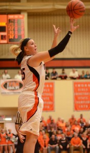 Lindsay Baker lets fly with a jumper during first-half action of the Warsaw Semistate Saturday night.