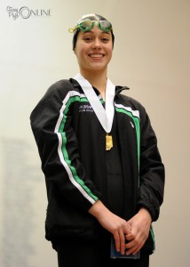 Bre Robinson stands proud after taking third place in the 100 freestyle.